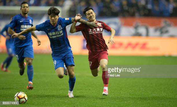 Chen Binbin of Shanghai SIPG and Li Xiaoming of in action during the 2018 Chinese Super League match between Shanghai Greenland Shenhua and Shanghai...