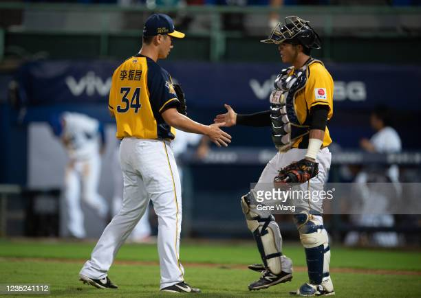 Chen Chang Lee of CTBC Brothers celebrates with teamates after pitching at the bottom of the 9th inning during the CPBL game between Fubon Guardians...
