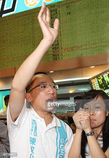 Chen Chihchung son of jailed former president Chen Shuibian gestures after winning a seat in the city council in Taiwan's second largest city...
