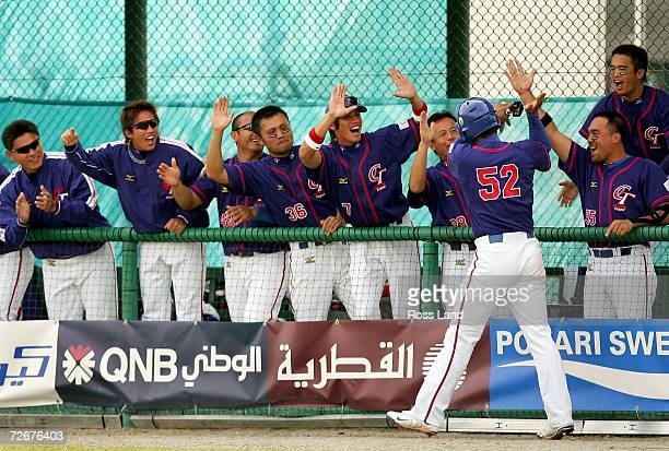 Chen Chin Feng of Chinese Taipei celebrates scoring with his teammates during the Round Robin game against the Republic of Korea at the 15th Asian...