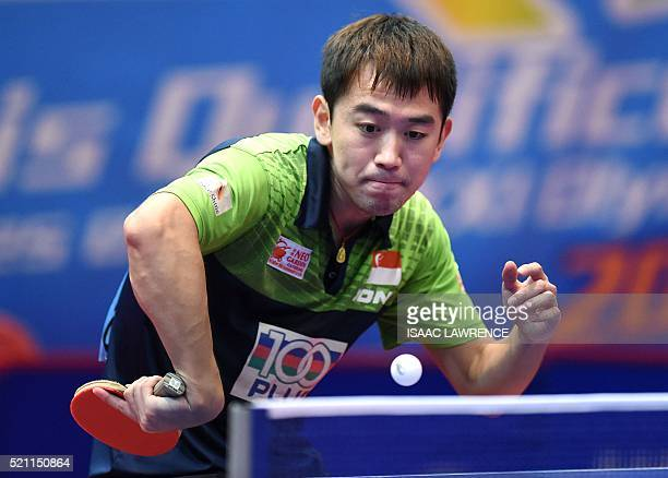 Chen Feng of Singapore returns the ball during the men's singles final match against Li Hu of Singapore the Asian Table Tennis Qualification...