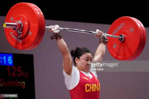 Chen Guiming of China competes in the women's 59kg weightlifting on day one of the Ready Steady Tokyo - Weightlifting, Tokyo 2020 Olympic Games test...