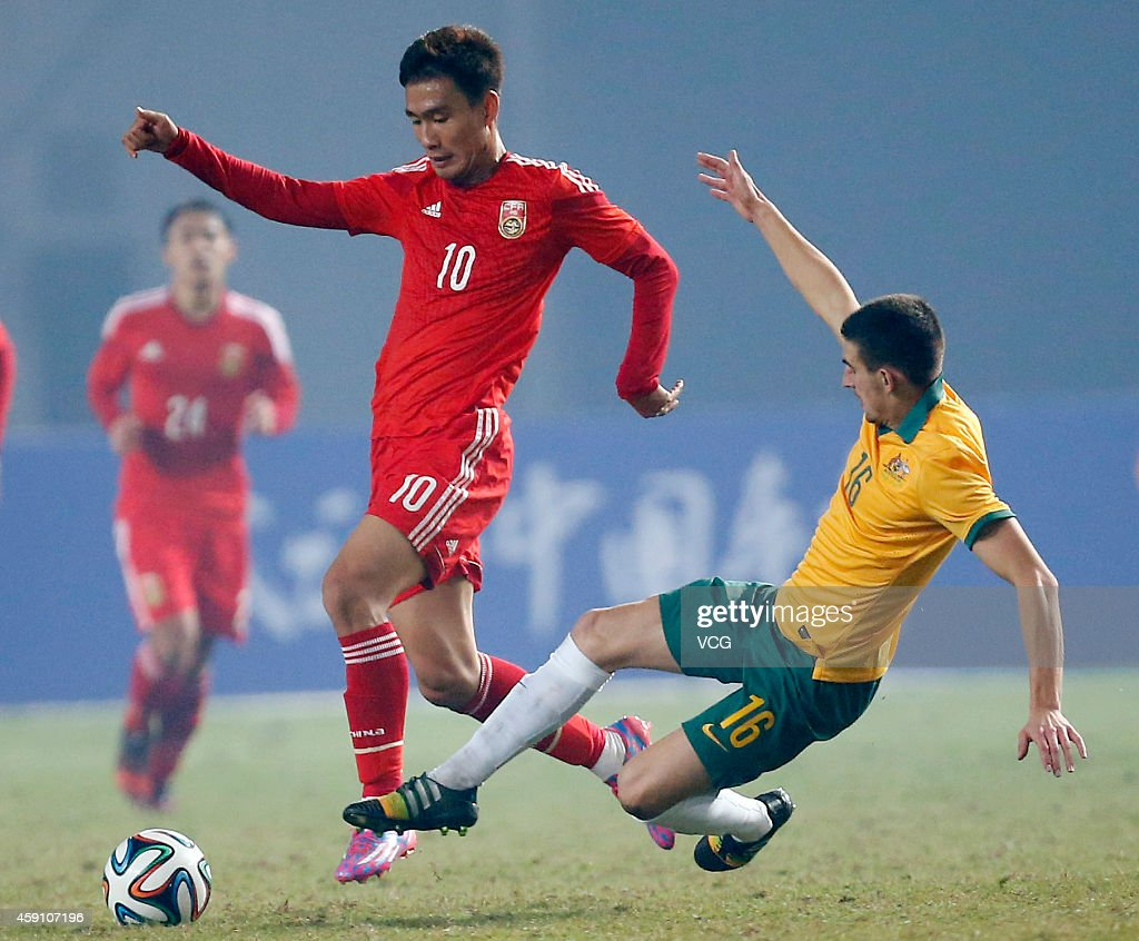 Chen Hao #10 of China and Steven Peter Ugarkovi #16 of Australia battle for the ball during the match between China U22 and Australia U22 on day three of the 'Wuhan City of Automobile' International Youth Football Tournament at Wuhan Sports Center Stadium on November 16, 2014 in Wuhan, China.
