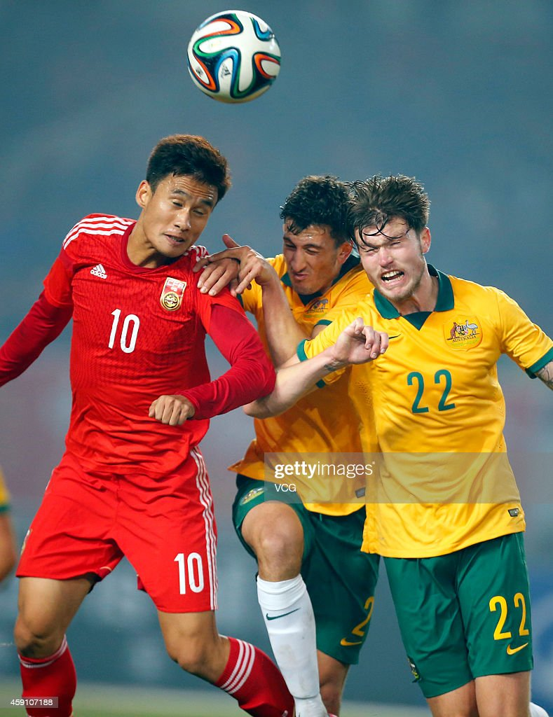 Chen Hao #10 of China, Giancario Gallifuoco #2 and Cameron Burgess #22 of Australia battle for the ball during the match between China U22 and Australia U22 on day three of the 'Wuhan City of Automobile' International Youth Football Tournament at Wuhan Sports Center Stadium on November 16, 2014 in Wuhan, China.