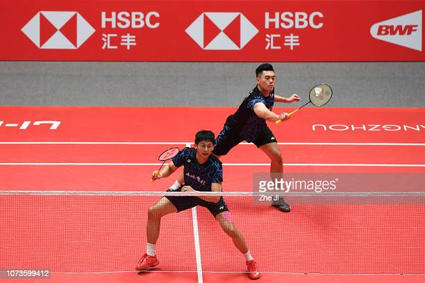 Chen Hung Ling and Wang ChiLin of Chinese Taipei compete against Li Junhui and Liu Yuchen of China during their men's doubles semifinals match on day...