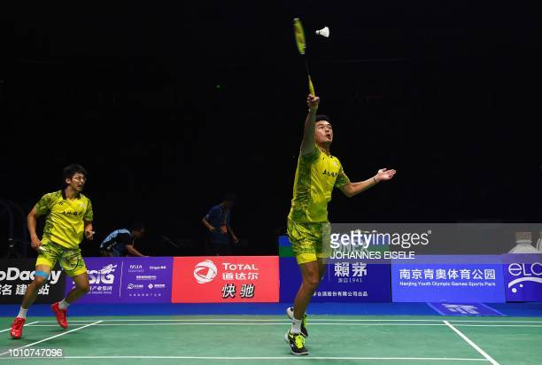 Chen Hung Ling and Wang ChiLin of Taiwan hit a shot against Takeshi Kamura and Keigo Sonoda of Japan in their men's doubles semifinal match during...
