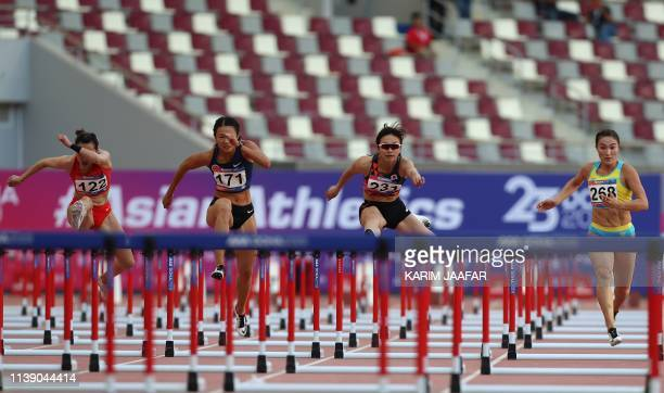 Chen Jiamin of China Lui Lai Yiu of Hong Kong Ayako Kimura of Japan and Aygerim Shynazbekova of Kazakhstan compete in the women's 100m hurdles race...