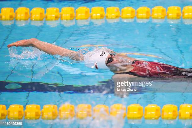 Chen Jie of China competes in the Women's 100m Backstroke on day 2 of the 2019 FINA Swimming World Cup at Jinan Olympic Sports Centre Stadium on...