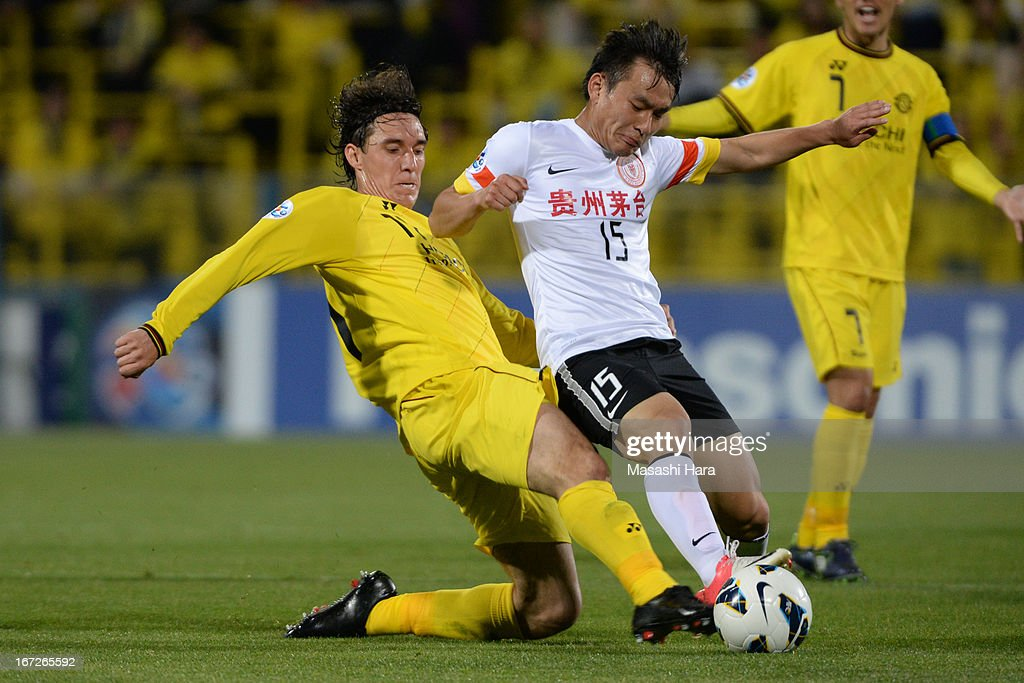 Chen Jie #15 of Guizhou Renhe (R) and Cleo #11 of Kashiwa Reysol compete for the ball during the AFC Champions League Group H match between Kashiwa Reysol and Guizhou Renhe at Hitachi Kashiwa Soccer Stadium on April 23, 2013 in Kashiwa, Japan.