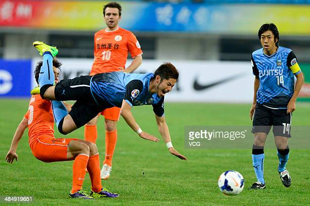 Chen Jie of Guizhou Renhe and Yusuke Tanaka of Kawasaki Frontale battle for the ball during the Asian Champions League match between Guizhou Renhe...