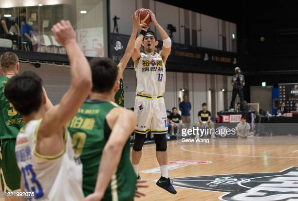 Chen Ju Lu of Yulon Luxgen Dinos attempts 3 point shot during the SBL Finals Game Six between Taiwan Beer and Yulon Luxgen Dinos at Hao Yu Trainning...