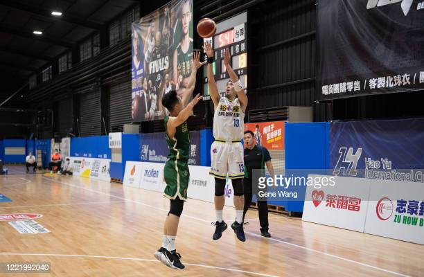 Chen Ju Lu of Yulon Luxgen Dinos attempts the shot during the SBL Finals Game Six between Taiwan Beer and Yulon Luxgen Dinos at Hao Yu Trainning...