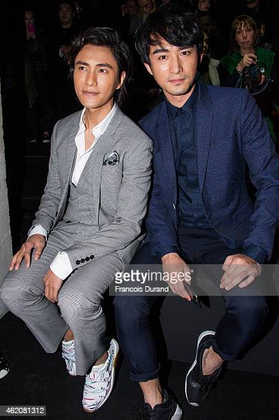Chen Kun and guest attend the Dior Homme Menswear Fall/Winter 20152016 Show as part of Paris Fashion Week on January 24 2015 in Paris France