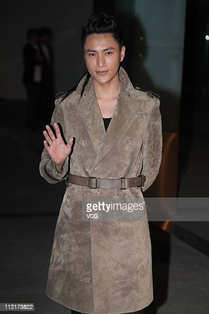 Chen Kun poses for photos as he arrives at the corporate event of the fashion apparel company Burberry at Sparkle Roll Plaza on April 13 2011 in...
