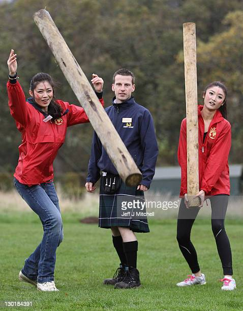 Chen Liu from China and Chu Hay Man Hyman from Hong Kong pose with Ross McMillan during the caber tossing at the Miss World Highland Games at Crieff...