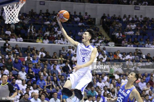 Chen Liu of Chinese Taipei soars for an open layup during thier FIBA World Cup Qualifiers against the Philippines Gilas Pilipinas defeated the...