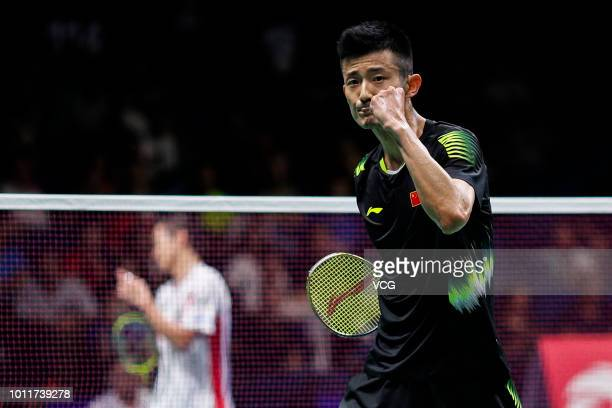 Chen Long of China celebrates after winning the Men's Singles third round match against Kenta Nishimoto of Japan on day four of TOTAL BWF World...