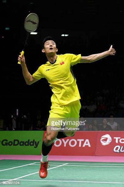 Chen Long of China competes against Kento Momota of Japan during the Thomas Cup Final match on day eight of the BWF Thomas & Uber Cup at Impact Arena...
