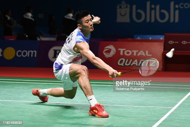 Chen Long of China competes against Tommy Sugiarto of Indonesia on day two of the Bli Bli Indonesia Open at Istora Gelora Bung Karno on July 17, 2019...