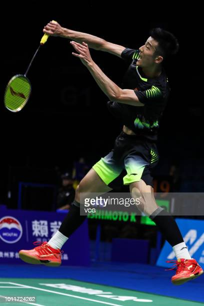 Chen Long of China competes in the Men's Singles eighth-final match against Kenta Nishimoto of Japan on day four of TOTAL BWF World Championships...