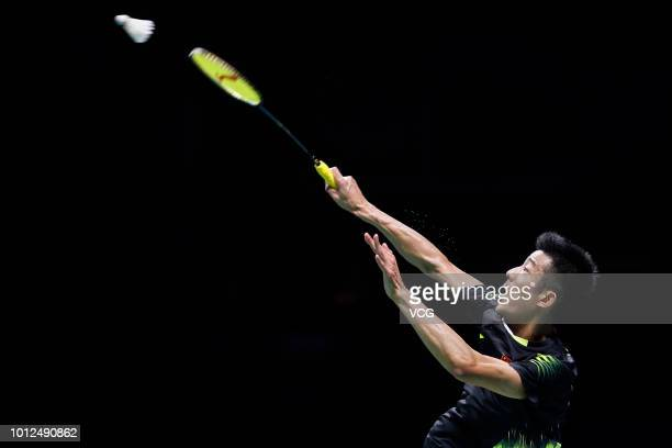 Chen Long of China competes in the Men's Singles quarter-final match against Viktor Axelsen of Denmark on day five of TOTAL BWF World Championships...