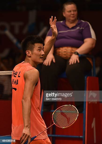 Chen Long of China gestures to his supporters after winning against Kento Momota of Japan during their semifinal men's singles match of the 2015...