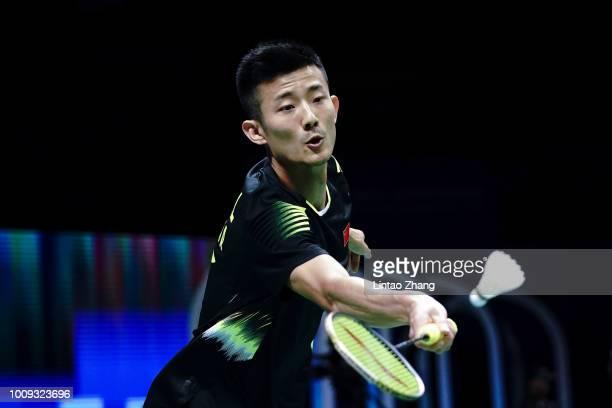 Chen Long of China hits a shot against Kenta Nishimoto of Japan in their Men's singles match during the Badminton World Championships at Nanjing...