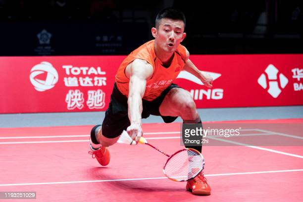 Chen Long of China in action against Viktor Axelsen of Denmark during their match on day 1 of the HSBC BWF World Tour Finals 2019 at Tianhe Sports...