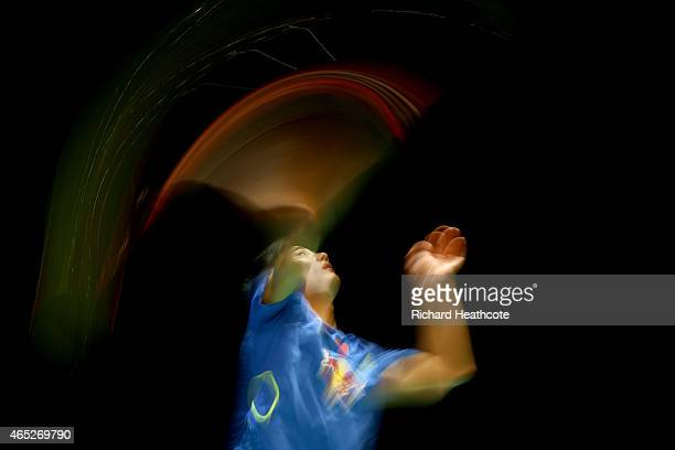 Chen Long of China in action on his way to winning his men's singles match against Hsu Jen Hao of Chinese Taipei during day three of YONEX All...