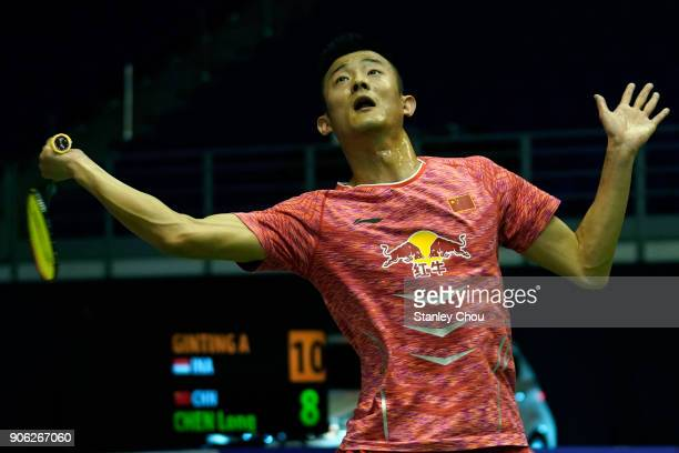 Chen Long of China plays a return shot to Anthony Sinisuka Ginting of Indonesia during the Men Singles round one match of the Perodua Malaysia...