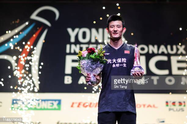 Chen Long of China poses with his trophy after the Men's Single final match against Jonatan Christie of Indonesia on day six of the French Open at...