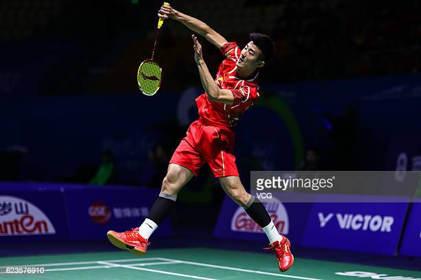Chen Long of China returns to Tommy Sugiarto of Indonesia during men's singles first round match on day one of BWF Thaihot China Open 2016 at Haixia...
