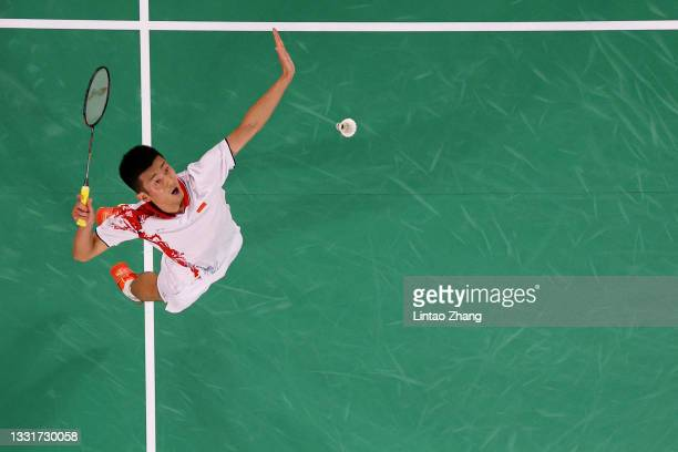 Chen Long of Team China competes against Anthony Sinisuka Ginting of Team Indonesia during a Men's Singles Semi-final match on day nine of the Tokyo...