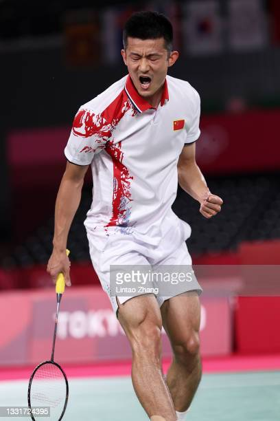 Chen Long of Team China reacts as he competes against Anthony Sinisuka Ginting of Team Indonesia during a Men's Singles Semi-final match on day nine...