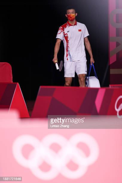 Chen Long of Team China steps into the court prior to the competition against Anthony Sinisuka Ginting of Team Indonesia during a Men's Singles...