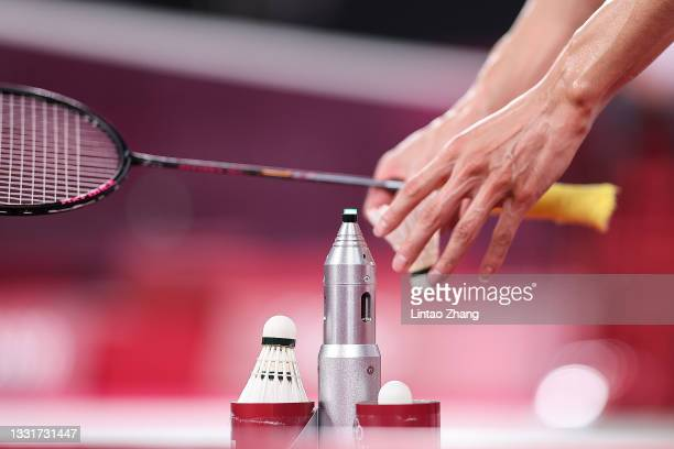 Chen Long of Team China takes a new shuttlecock as he competes against Anthony Sinisuka Ginting of Team Indonesia during a Men's Singles Semi-final...