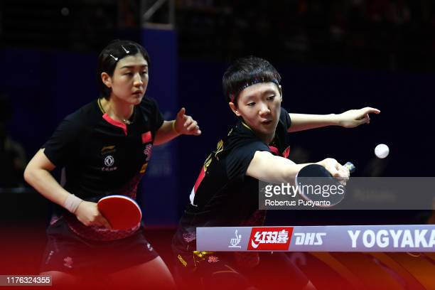Chen Meng and Wang Manyu of China compete against Ding Ning and Zhu Yuling of China during Women's Doubles finals match on day eight of the...