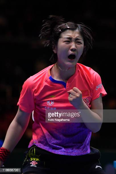 Chen Meng of China celebrates a point against Cheng I-Ching of Chinese Taipei during Women's Teams singles - Semifinals - Match 1 on day four of the...