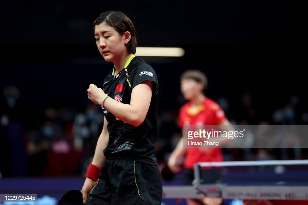 Chen Meng of China celebrates a point during the women's single final match between Wang Manyu of China during day four of 2020 ITTF Finals at...