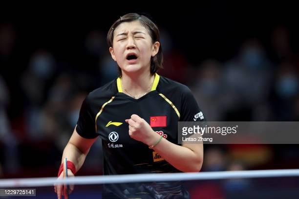 Chen Meng of China celebrates winning the women's single final match between Wang Manyu of China during day four of 2020 ITTF Finals at Zhengzhou...