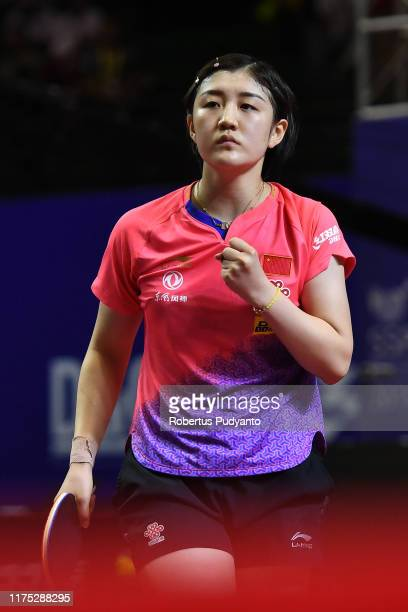 Chen Meng of China competes against Kasumi Ishikawa of Japan during Women's Team Champion Division final match on day three of the ITTF-Asian Table...