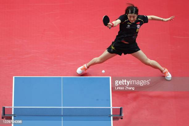 Chen Meng of China competes against Sun Yingsha of China in the Women's Singles - Semifinals during day three of 2020 ITTF Finals at Zhengzhou...