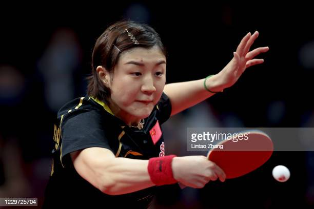 Chen Meng of China competes against Wang Manyu of China during women's single final match on day four of 2020 ITTF Finals at Zhengzhou Olympic Sports...