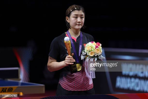Chen Meng of China poses with the trophy during the award ceremony after winning the Women's Singles final match against Wang Manyu of China on day...