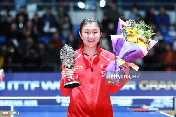 Chen Meng of China poses with trophy after winning the Women's Singles Finals match against He Zhuojia of China during day four of the 2018 ITTF...