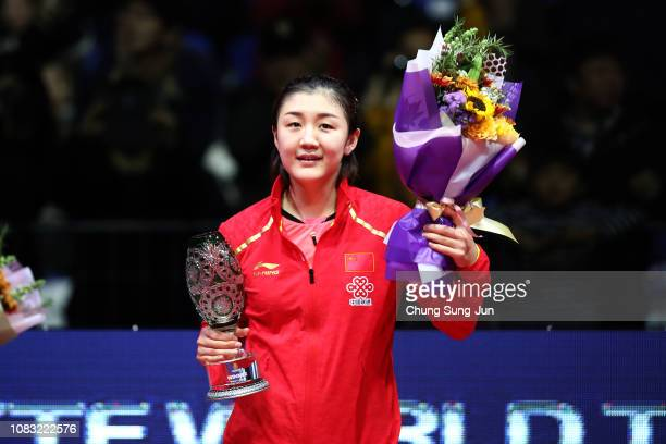 Chen Meng of China reacts celebrate with troply after winning the Women's Singles - Finals against He Zhuojia of China during day four of the World...