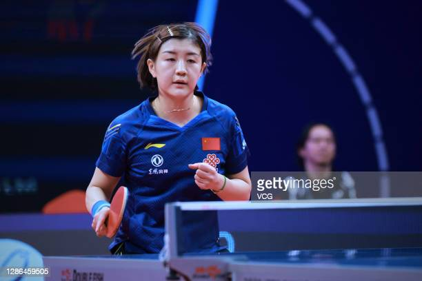 Chen Meng of China reacts in the Women's Singles Round of 16 match against Kato Miyu of Japan on day one of the 2020 ITTF Finals at Zhengzhou Olympic...