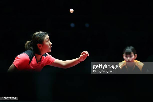 Chen Meng of China serves in the Women's Singles Finals against He Zhuojia of China during day four of the World Tour Grand Finals at Namdong...