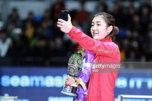 Chen Meng of China takes a selfie after winning the Women's Singles Finals match against He Zhuojia of China during day four of the 2018 ITTF World...