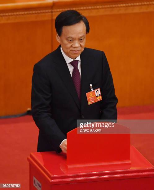 Chen Miner Communist Party Secretary of Chongqing poses as he votes during the fifth plenary session of the first session of the 13th National...